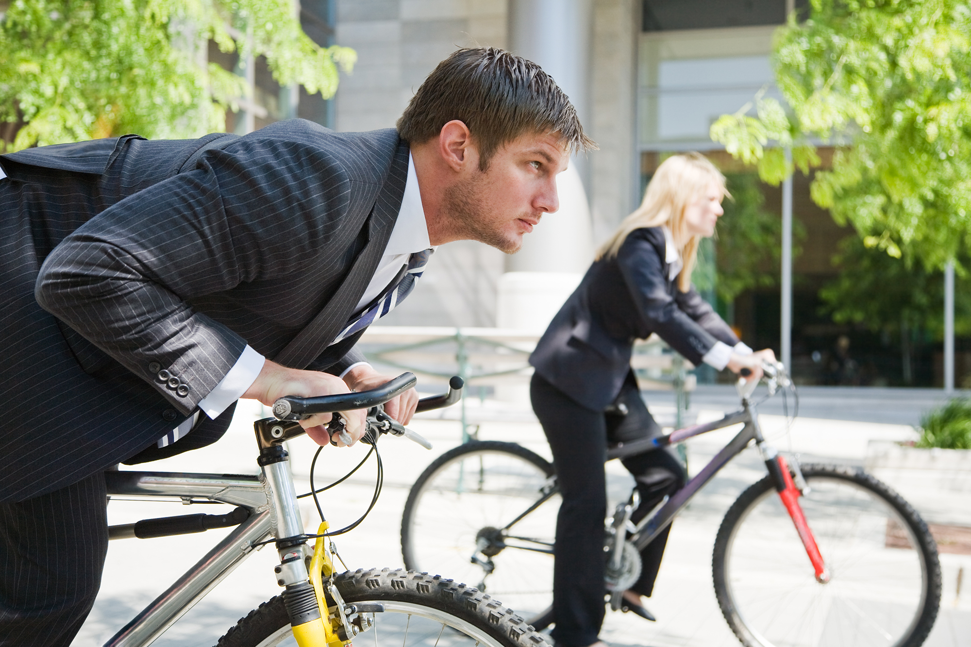 Business people on bicycles