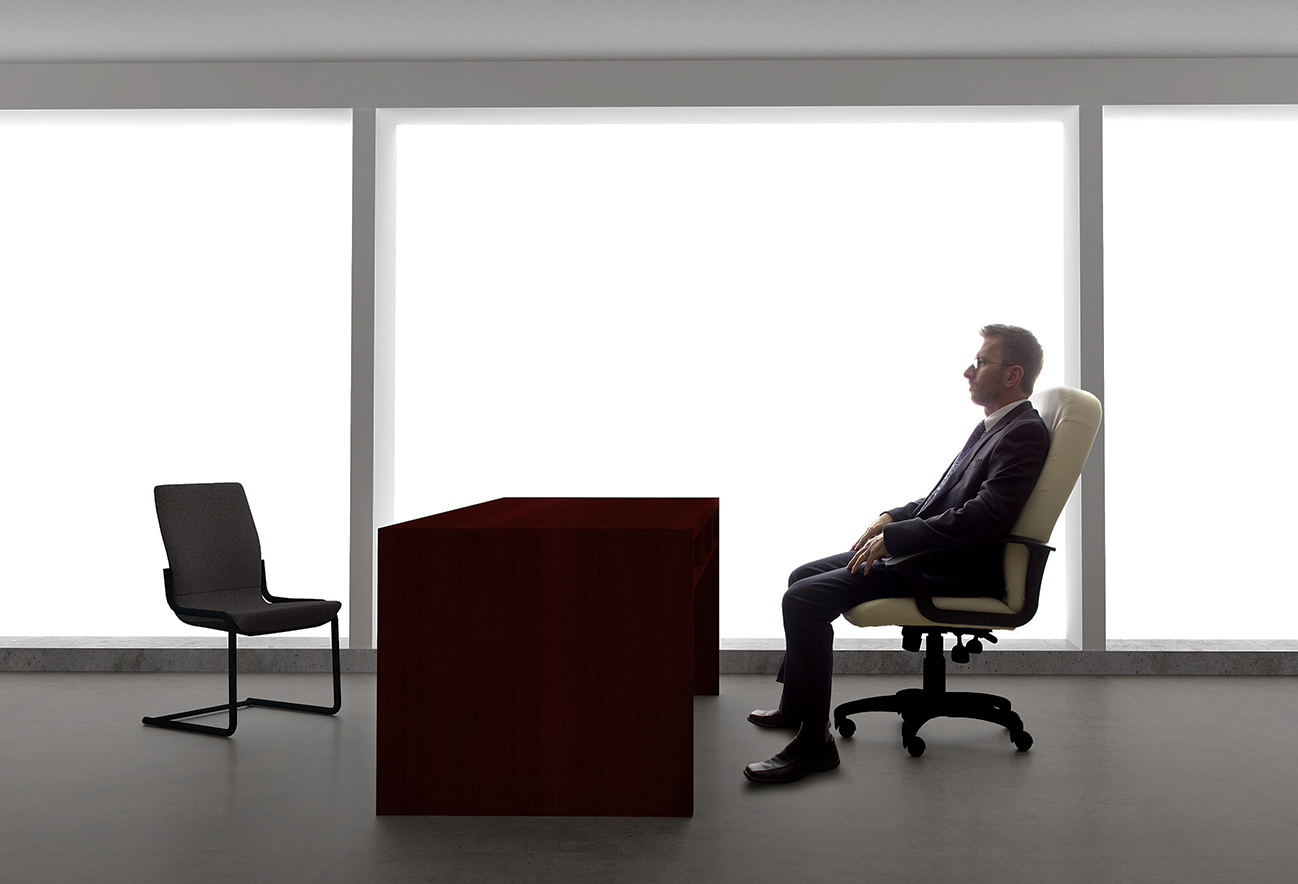 Businessman sitting at empty desk