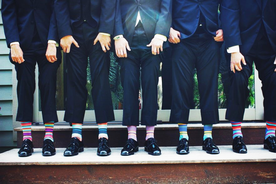 Men wearing suits and bright colored socks